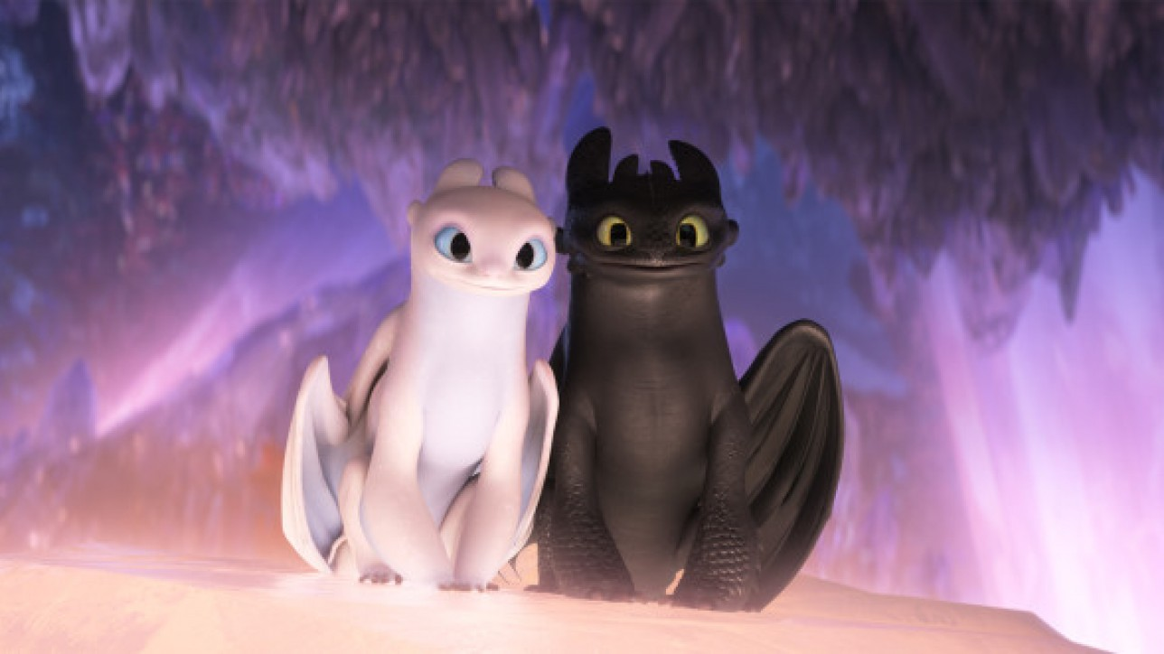 The female Light Fury dragon and Night Fury dragon Toothless in DreamWorks Animation's How To Train Your Dragon: The Hidden World, directed by Dean DeBlois.